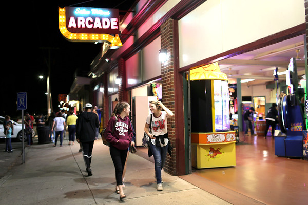 HADLEY GREEN/Staff photo<br /> People walk next to the arcade on a Thursday night at the Salem Willows.<br /> <br /> 08/31/17