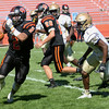 HADLEY GREEN/Staff photo<br /> Beverly's Ameer Alshrafi (2) runs through Malden defenders to make a touchdown at the Beverly v. Malden boys varsity football game held at the Hurd Stadium in Beverly. <br /> 09/23/17