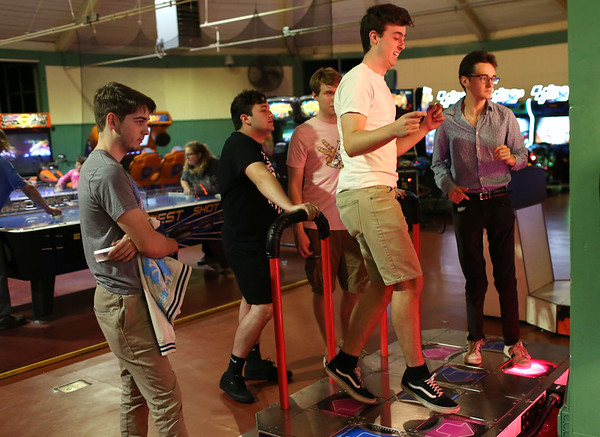 HADLEY GREEN/Staff photo<br /> Harry Fecteau and Thomas Rutigliano of Beverly play Dance Dance Revolution at the Willows arcade in Salem.<br /> <br /> 08/31/17