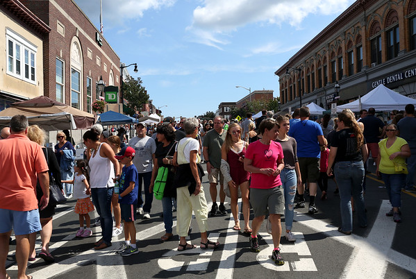 HADLEY GREEN/Staff photo<br /> People walk through food vendors that lined Main Street at the International Festival in Peabody.<br /> 09/10/17