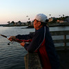 HADLEY GREEN/Staff photo<br /> Jose Valencia of Medford fishes for mackerel at sunrise off the pier at the Willows. Jose came on a quiet morning with his friend, Nick Sison, left, of Salem.<br /> <br /> 08/31/17
