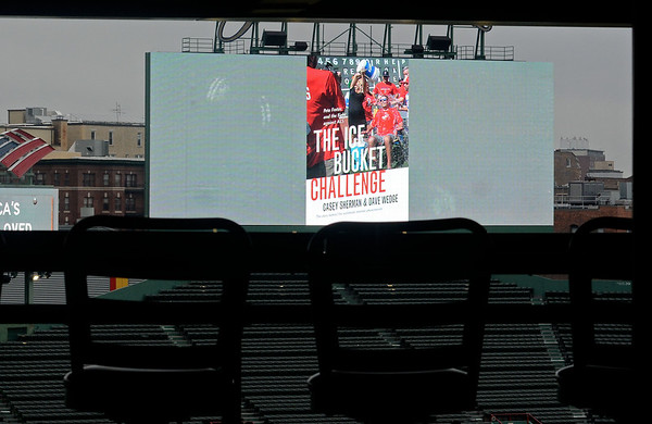 """RYAN HUTTON/ Staff photo<br /> The cover of """"The Ice Bucket Challenge"""" is displayed on the Fenway Park big screen on Monday night during an event to launch the book and honor its subject, Beverly native and ALS sufferer Pete Frates."""