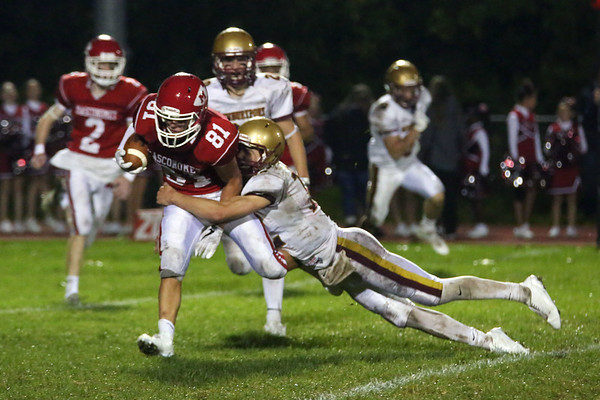 HADLEY GREEN/Staff photo<br /> Newburyport's Own Bradbury (12) tackles Masco's Marshall Lastes (18) at the Masco v. Newburyport boys varsity football game held at Masconomet High School.<br /> 09/22/17