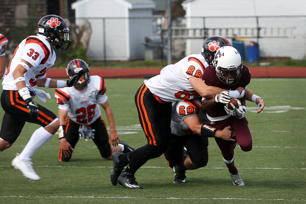HADLEY GREEN/Staff photo<br /> Beverly seniors Justin Cattell (88) and Paul O'Feish (68) tackle Lynn's Mathies Fowler (1) at the Lynn English v. Beverly football game at the Manning Field in Lynn.<br /> 09/09/17