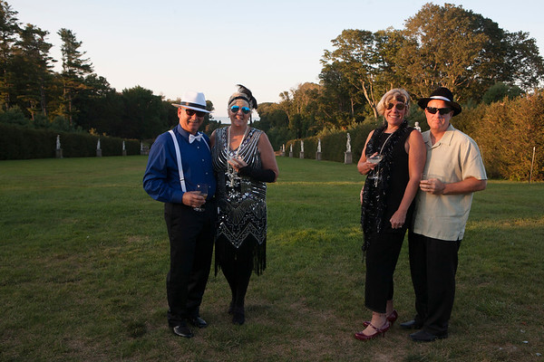 AMY SWEENEY/Staff photo.<br /> Joseph and Marcia Vitale, from left,  with Leslie and Robert  Frost, at the speakeasy at the Castle at the Crane Estate in Ipswich.  A 1920's speakeasy, an illicit establishment that sells alcoholic beverages, was reenacted at the Castle at  Crane Estate on Aug. 30. Guests went through the basement door with a special password and were lead up to the main floor.  Many got into the spirit wearing attire from that era.  The event featured live jazz, self guided tours, rooftop views, nibbles, and prohibition libations.<br /> Aug. 30, 2017