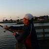 HADLEY GREEN/Staff photo<br /> Jose Valencia of Medford fishes for mackerel at sunrise off the pier at the Willows. <br /> <br /> 08/31/17