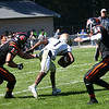 HADLEY GREEN/Staff photo<br /> Beverly's Clayton McAlpine (12) and Ryan Barror (11) tackle Malden's Edouard Bazile (1) at the Beverly v. Malden boys varsity football game held at the Hurd Stadium in Beverly. <br /> 09/23/17