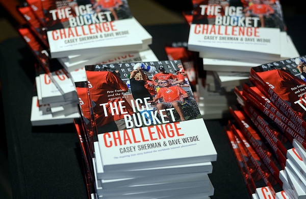 """RYAN HUTTON/ Staff photo<br /> Copies of the book """"The Ice Bucket Challenge"""" by Casey Sherman and Dave Wedge were for sale at the State Street Pavilion at Fenway Park on Monday night during an event to launch the book and honor its subject, Beverly native and ALS sufferer Pete Frates."""
