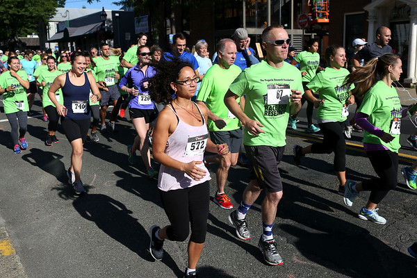 HADLEY GREEN/Staff photo<br /> People run at the 16th annual International Race for Research to benefit the Progeria Research Foundation in Peabody.<br /> 09/09/17