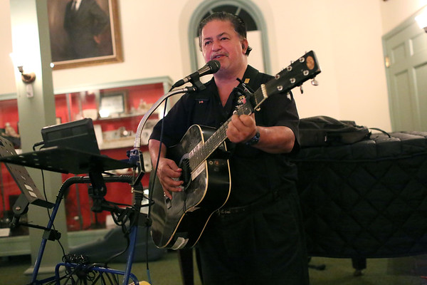 HADLEY GREEN/Staff photo<br /> C.C. Yanakakis plays guitar at the Open Mic hosted by the Danvers Historical Society at Tapley Memorial Hall.<br /> 09/20/17