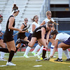 HADLEY GREEN/Staff photo<br /> Marblehead's Hadley Carlton (21) runs through Peabody defenders towards the goal at the Peabody v. Marblehead girls varsity field hockey game at Peabody High School.<br /> 09/26/17