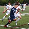 HADLEY GREEN/Staff photo<br /> Peabody's Noah Surman (25) and Beverly's Conor Hanlon (22) vie for the ball at the Beverly v. Peabody boys varsity soccer game at Beverly High School.<br /> 09/20/17