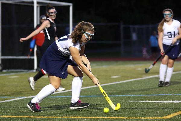 HADLEY GREEN/Staff photo<br /> Peabody's Elizabeth Curcio (30) runs with the ball at the Peabody v. Marblehead girls varsity field hockey game at Peabody High School.<br /> 09/26/17