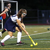 HADLEY GREEN/Staff photo<br /> Peabody's Elizabeth Curcio (30) runs with the ball at the Peabody v. Marblehead girls varsity field hockey game at Peabody High School.<br /> 09/26/17