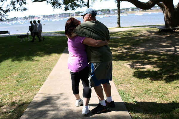 """HADLEY GREEN/Staff photo<br /> Kathy Hanlon and Joe Santoro embrace at the Willows park in Salem. Joe has worked as a mechanic at the park for four years and thinks it's """"excellent."""" <br /> <br /> 09/01/17"""