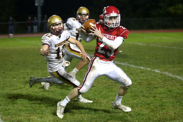 HADLEY GREEN/Staff photo<br /> Masco's Peter Kitsakos (23) runs up the field with the ball while Newburyport's Owen Bradbury (12) prepares to tackle him at the Masco v. Newburyport boys varsity football game held at Masconomet High School.<br /> 09/22/17