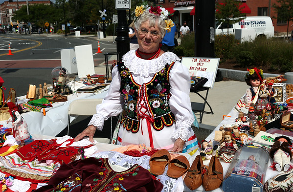 HADLEY GREEN/Staff photo<br /> Alice Zujewski, a former Peabody resident, displays Polish clothing, dolls, and figurines from her personal collection at the International Festival in Peabody.<br /> 09/10/17
