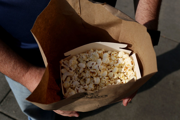 HADLEY GREEN/Staff photo<br /> Cliff McKenney gets popcorn from E.W. Hobbs at the Willows park in Salem. McKenney has been coming to the Willows for over forty years, and says popcorn is one of his favorite parts of the park. <br /> <br /> 08/31/17