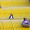 HADLEY GREEN/Staff photo<br /> Adryanna Figueiredo, 7, Angelis Espillat, 6, and Mia Sofia Feliz, 6, all of Salem, fly down the giant slide at the Topsfield Fair.<br /> 09/29/17