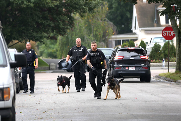 HADLEY GREEN/Staff photo<br /> Regional police walk with K-9 dogs near Beverly Bank in Danvers after a robbery occurred Wednesday afternoon.<br /> <br /> 09/06/17