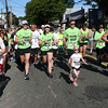 HADLEY GREEN/Staff photo<br /> People run from the finish line at the 16th annual International Race for Research to benefit the Progeria Research Foundation.<br /> 09/09/17
