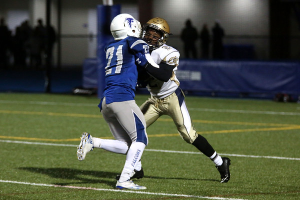 HADLEY GREEN/Staff photo<br /> Danvers' Colby Holland (21) pushes Malden's Reggie Charles (2), with the ball, back towards the end zone at the Danvers v. Malden boys varsity football game. 09/30/17
