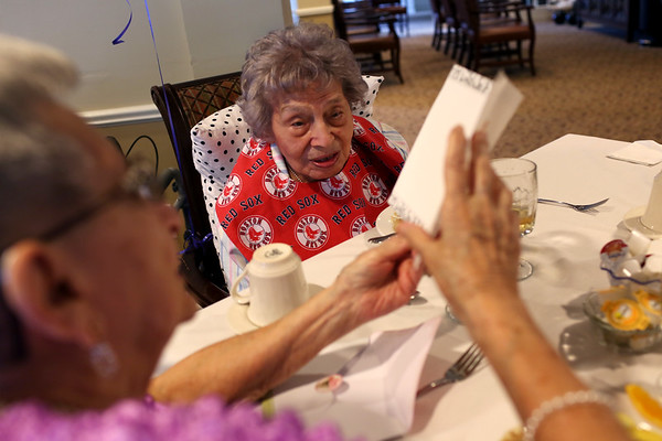 """HADLEY GREEN/ Staff photo<br /> Concetta """"Connie"""" Rando receives well wishes during her 107th birthday party at Brookdale in Danvers.<br /> <br /> 09/26/2018"""
