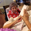 "HADLEY GREEN/ Staff photo<br /> Concetta ""Connie"" Rando receives well wishes during her 107th birthday party at Brookdale in Danvers.<br /> <br /> 09/26/2018"