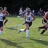 HADLEY GREEN/ Staff photo<br /> Hamilton-Wenham's Sarah Cooke (14) runs with the ball at the Hamilton-Wenham v. Amesbury field hockey game in Hamilton.<br /> <br /> 09/24/2018