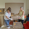 MIKE SPRINGER/Staff photo<br /> Teachers Ghaisaa Ibrahim, left, and Tammy Alto sort through boxes as the Pathways for Children staff moved into its new space Friday at the Horace Mann Laboratory School in Salem.<br /> 9/7/2018