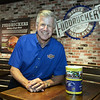 CARL RUSSO/staff photo. SALEM NEWS: Jim Boland, CEO/owner of four local Fuddruckers stands next to a donation can at the Reading restaurant. Jim Boland, CEO/ owner of four local Fuddruckers shares his story about how he got involved in an annual cure for cancer ride called A Reason to Ride. The ride was founded by a Peabody resident named Tom DesFosses. 9/6/2018