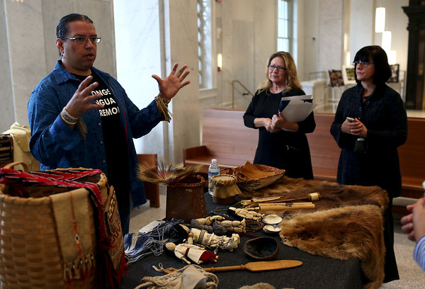 HADLEY GREEN/ Staff photo<br /> Jonathan Perry of the Aquinnah Wampanoag Tribe speaks about Wampanoag artifacts during the Massachusetts Trial Court Cultural Appreciation Week celebration at the Essex Probate and Family Court in Salem.<br /> <br /> 09/28/2018