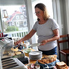 HADLEY GREEN/ Staff photo<br /> Beth Roenker serves homemade pancakes for guests in the morning at the Seafarer Inn.<br /> <br /> 09/21/2018