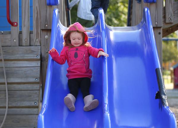 HADLEY GREEN/ Staff photo<br /> Audrey Lewellen, 2, of Hamilton, goes down the slide at Patton Park in Hamilton. <br /> <br /> 09/24/2018
