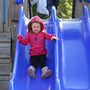 HADLEY GREEN/ Staff photo<br /> Audrey Lewellen, 2, of Hamilton, goes down the slide at Patton Park in Hamilton. <br /> <br /> 09/24/2018