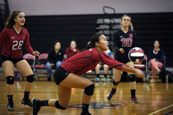 HADLEY GREEN/ Staff photo<br /> Marblehead's Anna Arbo (1) lunges to return the ball to Saugus during the girls volleyball game at Marblehead High School.<br /> <br /> 09/25/2018