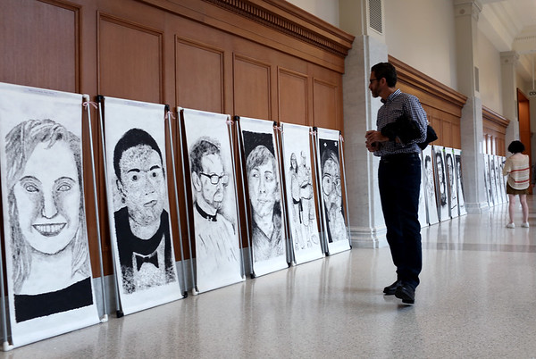 HADLEY GREEN/ Staff photo<br /> People look at artwork created by students at the Clark School and the Beverly Children's Learning Center at the Massachusetts Trial Court Cultural Appreciation Week celebration at the Essex Probate and Family Court in Salem.<br /> <br /> 09/28/2018