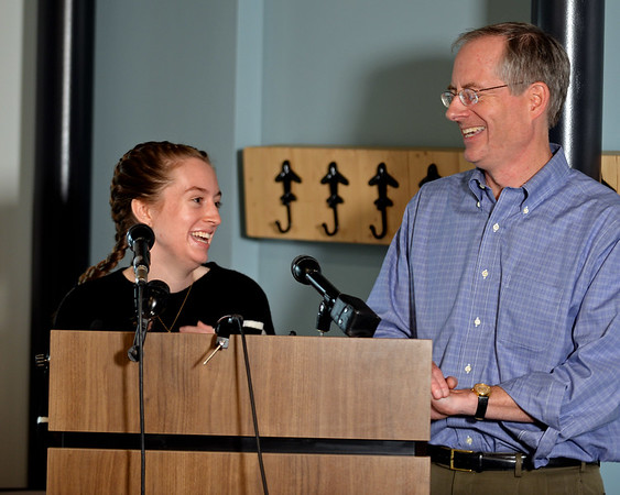 RYAN HUTTON/ Staff photo<br /> Student pilot Maggie Taraska, 17, left, shares a laugh with her dad Walter at a news conference at the Beverly Airport on Monday after she she made a successful emergency landing on Sunday when one of her plane's wheels fell off during takeoff.