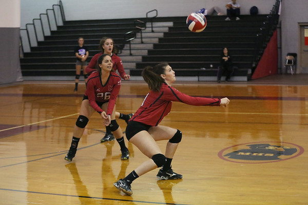 HADLEY GREEN/ Staff photo<br /> Marblehead's Haley Lemieux (4) returns the ball to Saugus during the girls volleyball game at Marblehead High School.<br /> <br /> 09/25/2018
