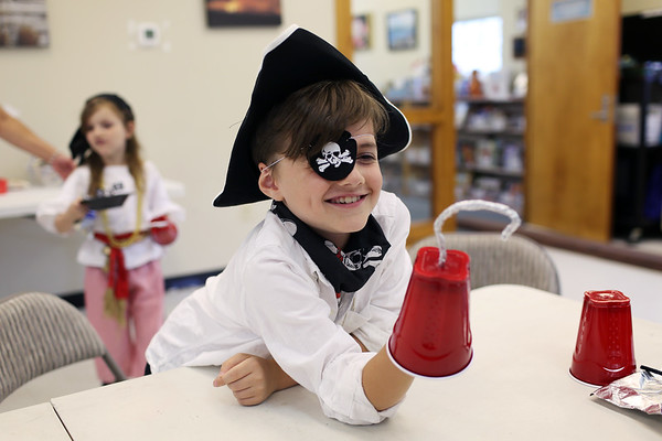 HADLEY GREEN/ Staff photo<br /> Ralph Gerber, 8, of Peabody, tries out his new pirate hook at the Peabody Institute Library's Talk Like A Pirate Day event at the library's south branch in Peabody. <br /> <br /> 09/19/2018