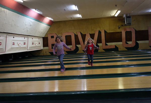HADLEY GREEN/ Staff photo<br /> Kaitlynn and Audrey Foote run through the empty bowling lanes at the liquidation sale at Bowl-O-Mat in Beverly.<br /> <br /> 09/26/2018