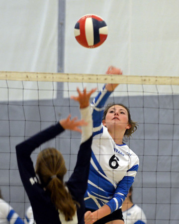 RYAN HUTTON/ Staff photo<br /> Danver's Carly Goodhue fires a shot over the net during Monday's volleyball match against  Hamilton-Wenham at Danvers High School.