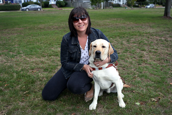 HADLEY GREEN/ Staff photo<br /> Allison Camire sits with her guide dog, Kennedy, at the Dane Street Beach park in Beverly.<br /> <br /> 09/24/2018