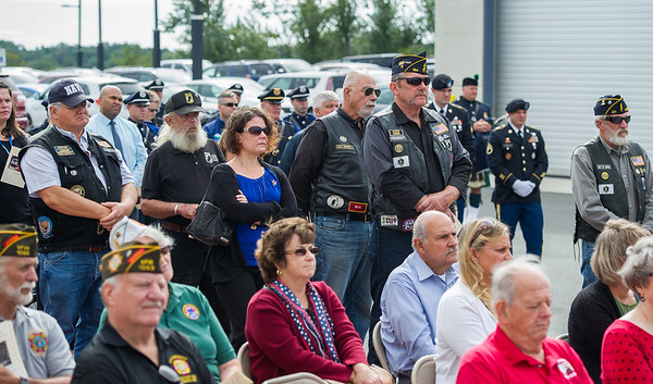 AMANDA SABGA/Staff photo   People listen during the Essex County Sheriff's Department National POW/MIA Recognition Day Ceremony at the sheriff's department in Middleton.  9/21/18