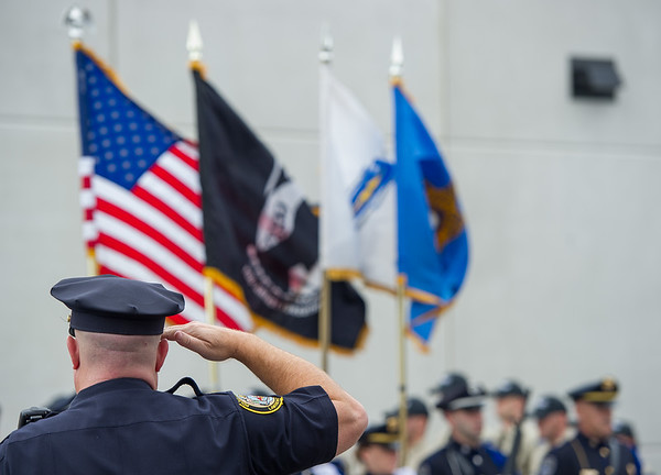AMANDA SABGA/Staff photo <br /> <br /> Lawrence Police Captain Scott McNamara stands at attention during the Essex County Sheriff's Department National POW/MIA Recognition Day Ceremony at the sheriff's department in Middleton.<br /> <br /> 9/21/18