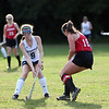 HADLEY GREEN/ Staff photo<br /> Hamilton-Wenham's Grace Condon (9) and Amesbury's Twombly (18) vie for the ball at the Hamilton-Wenham v. Amesbury field hockey game in Hamilton.<br /> <br /> 09/24/2018
