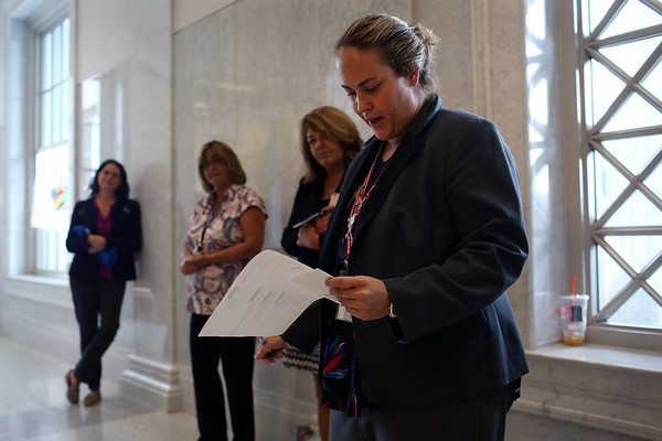 HADLEY GREEN/ Staff photo<br /> Emily Day, a probation officer, reads aloud a poem at the Massachusetts Trial Court Cultural Appreciation Week celebration at the Essex Probate and Family Court in Salem.<br /> <br /> 09/28/2018