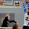RYAN HUTTON/ Staff photo<br /> Hamilton-Wenham's Rose Wosepka fires the ball over the net during Monday's volleyball match at Danvers High School.