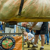 AMANDA SABGA/Staff photo <br /> <br /> Judge George Hoomis of Ipswich brushes under a pumpkin checking for soft spots during the Giant Pumpkin Weigh Off on the first night at Topsfield fair.<br /> <br /> 9/28/18