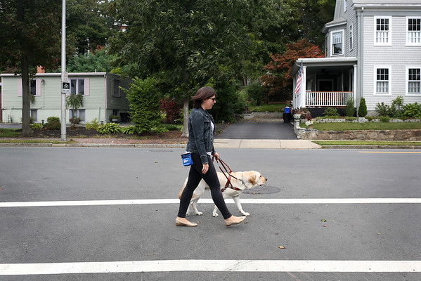 HADLEY GREEN/ Staff photo<br /> Allison Camire walks with her guide dog, Kennedy, near her home in Beverly.<br /> <br /> 09/24/2018